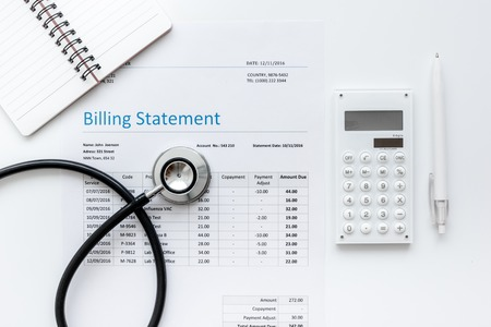 Photo pour health care billing statement with doctor's stethoscope on white table background top view mock-up - image libre de droit