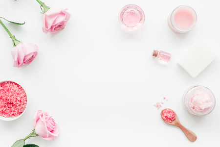 Photo pour rose organic cosmetics with salt, cream and oil on white table background top view - image libre de droit
