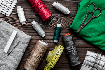 Foto de tools for sewing for hobby set on wooden table background top view pattern - Imagen libre de derechos