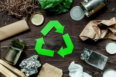 Foto de Eco concept with recycling symbol on wooden table background top view - Imagen libre de derechos