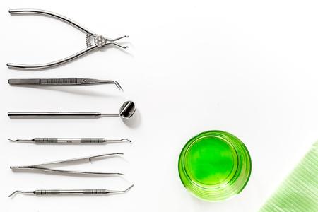 Foto de dentist desk with instruments on white background top view mock up - Imagen libre de derechos