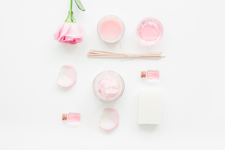 Photo for cosmetic set with rose blossom and body cream on white desk background top view - Royalty Free Image