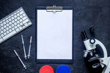 Foto de Heathcare concept. Medical tests. Microscope, syringe, Petri dish on grey stone background top view. - Imagen libre de derechos