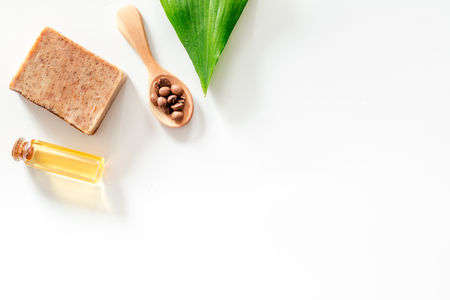 Photo pour Homemade skin care. Coffee soap on white background top view. - image libre de droit