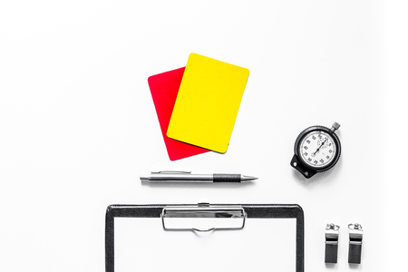 Foto de Set to judge competition. Yellow and red cards, stopwatch, whistle, pad on wooden background top view. - Imagen libre de derechos