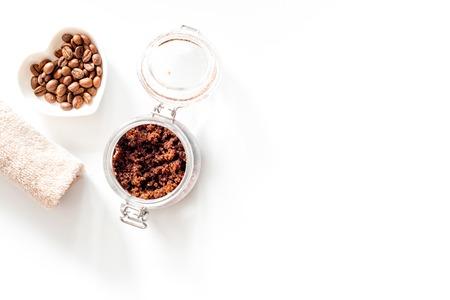 Photo pour Spa treatment. Coffee scrub on white background top view. - image libre de droit