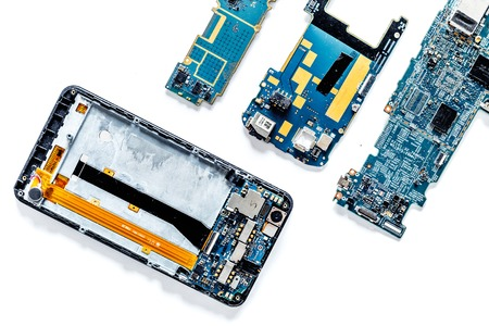 Photo pour Parts of disassembled cell phone on white background top view copyspace - image libre de droit