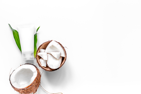 Photo for Body treatment. Coconut cosmetics on white background top view copyspace. - Royalty Free Image