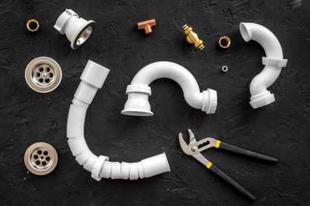 Foto de Plumber tools on black background top view. - Imagen libre de derechos