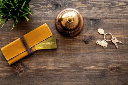 Foto de Hotel service bell on dark wooden table background top view. - Imagen libre de derechos