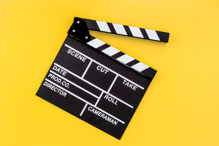 Photo for Filmmaker profession. Clapperboard on yellow background top view copyspace - Royalty Free Image