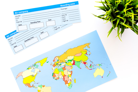 Photo pour Planing trip with tickets and world map on white table background top view - image libre de droit