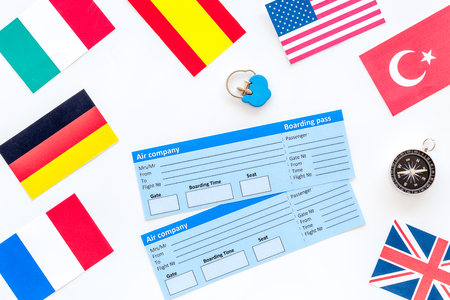 Photo pour accessories for treveling with flags and tickets on office desk white background top view - image libre de droit