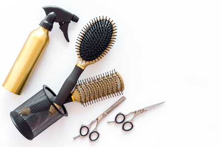 Foto de combs and hairdresser tools for styling on white work desk background top view mockup - Imagen libre de derechos