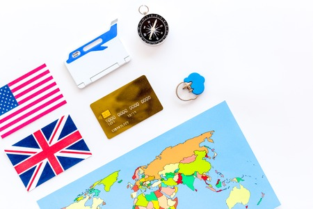 Photo pour accessories for treveling with flags, map and credit card on office desk background top view - image libre de droit