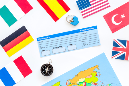 Photo pour planing trip with tickets, flags and map on white background top view - image libre de droit
