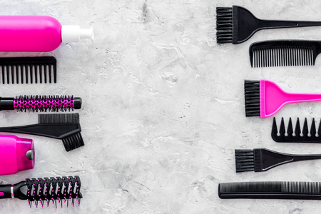 Photo pour beauty salon pink work tools with comb for hair dress and coloring on stone desk background top view mock up - image libre de droit