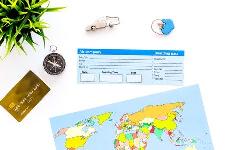 Photo pour accessories for treveling with tickets, map and credit card on office desk white background top view - image libre de droit