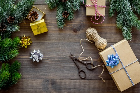 Foto de gifts wrapping set for new year and christmas 2018 greeting on wooden table background top veiw mock up - Imagen libre de derechos