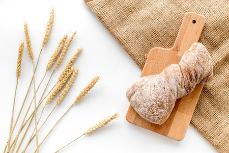 Foto de bakery shop set with fresh wheaten bread on table white background top view - Imagen libre de derechos