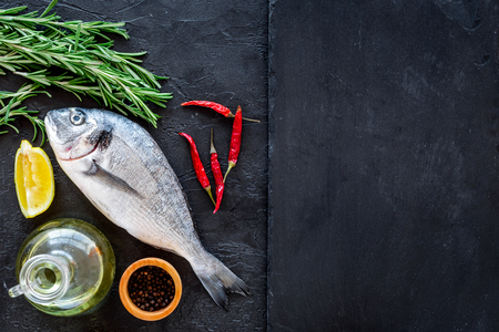 Photo for Preparing fresh sea fish. Black background top view. - Royalty Free Image