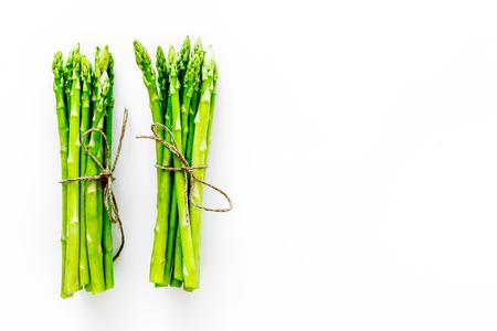 Photo pour Sprout of fresh asparagus on white background top view. - image libre de droit