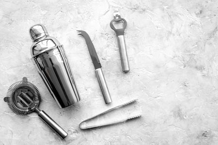 Photo pour Bar tools for making cocktails on grey stone background top view. - image libre de droit