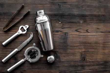 Photo pour Instruments bartender. Shaker, strainer on wooden background top view. - image libre de droit