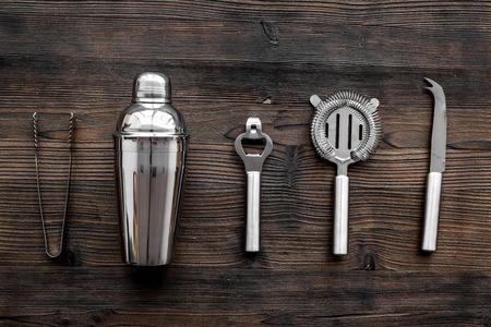 Photo pour Instruments bartender. Shaker, strainer on wooden background top view - image libre de droit