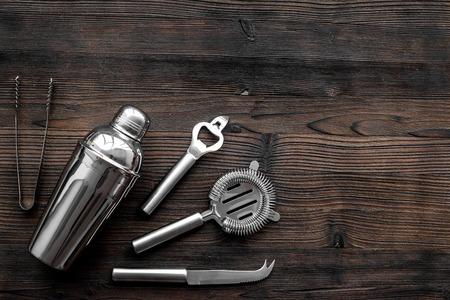 Photo pour Instruments bartender. Shaker, strainer on wooden background top view copyspace - image libre de droit
