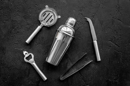 Photo pour Instruments bartender. Shaker, strainer on black background top view - image libre de droit