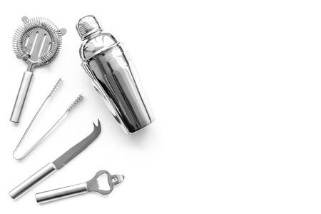 Photo pour Barman equipment. Shaker, strainer on white background top view copyspace - image libre de droit