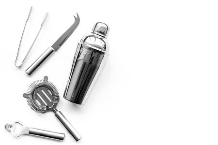 Photo pour Barman equipment. Shaker, strainer on white background top view. - image libre de droit