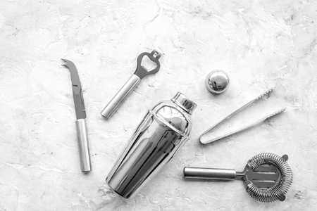 Photo pour Bar tools for making cocktails on grey stone background top view copyspace - image libre de droit