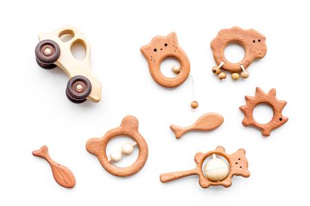 Photo pour Cute wooden handmade toys for newborn on white background top view - image libre de droit