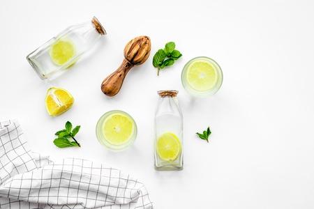 Foto de Prepare refreshing beverage lemonade. Lemons, juicer, bottle on white background top view. - Imagen libre de derechos