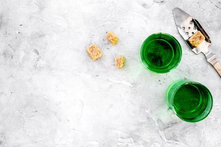 Foto de Traditions of drinking absinthe. Special spoon and sugar cubes near shots on grey background top view copy space - Imagen libre de derechos