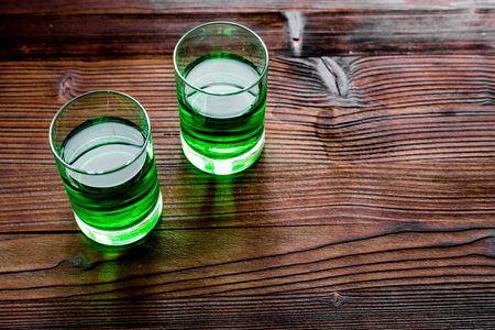 Foto de Absinthe shots on dark wooden background top view. - Imagen libre de derechos