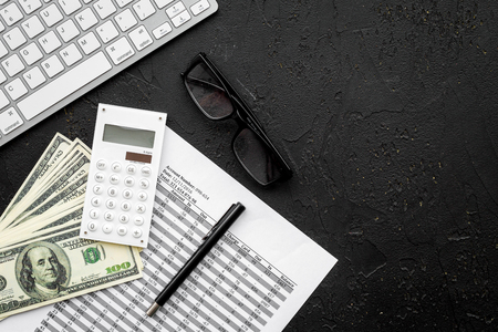 Photo pour Pay taxes. Documents near calculator, money, glasses, keyboard on black background top view copy space - image libre de droit