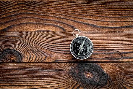 Photo for Compass on dark wooden background top view copy space. - Royalty Free Image
