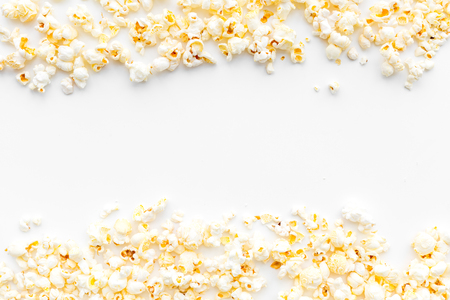 Foto de Popcorn background on white top view copy space. - Imagen libre de derechos