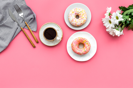 Photo for breakfast with coffee, donuts and flowers on pink background top view mockup - Royalty Free Image