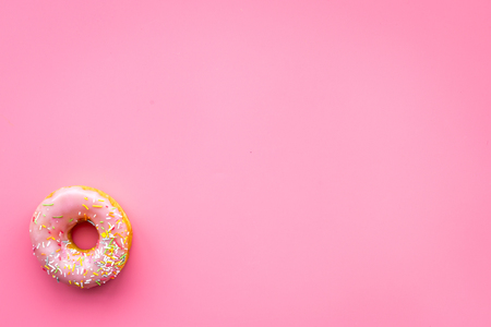 Photo for Sweet tasty snack. Glazed donut on pink background top view copy space - Royalty Free Image