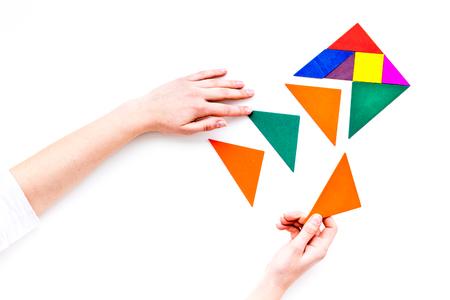 Foto de Business solutions, success and strategy. Puzzle with paper pieces on office desk white background top view mock-up - Imagen libre de derechos
