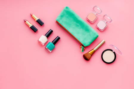Photo pour Women desk with decorative cosmetics for make up on pink background flat lay space for text - image libre de droit