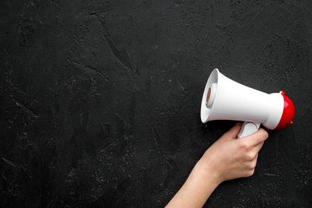 Photo pour Megaphone make an announcement on black background top view copy space - image libre de droit