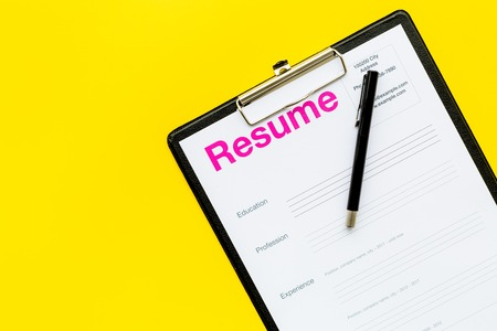 Photo for Looking for work concept. Resume on pad with on yellow background top view. - Royalty Free Image