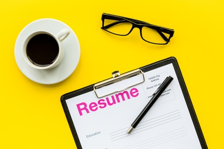 Photo for Recruitment. Select employees. Resume near coffee, glasses on yellow background top view. - Royalty Free Image