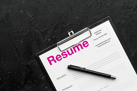 Photo for Employment concept. Resume on pad near pen and glasses on black background top view. - Royalty Free Image
