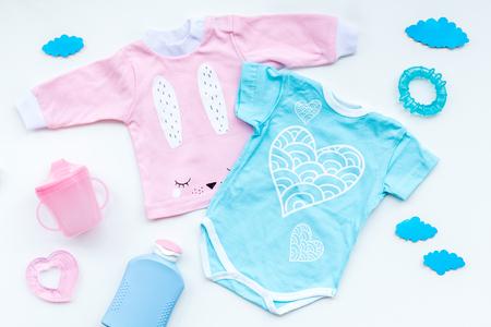 Foto für Baby shower concept. Baby's clothes and accessories on light background top view. - Lizenzfreies Bild